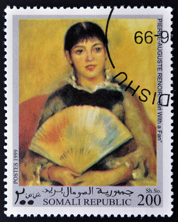 philatelic: REPUBLIC SOMALI - CIRCA 1999: A stamp printed in Somalia shows Girl with a fan by Renoir, circa 1999 Stock Photo