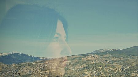 mountainscape: Double exposure of woman and mountainscape