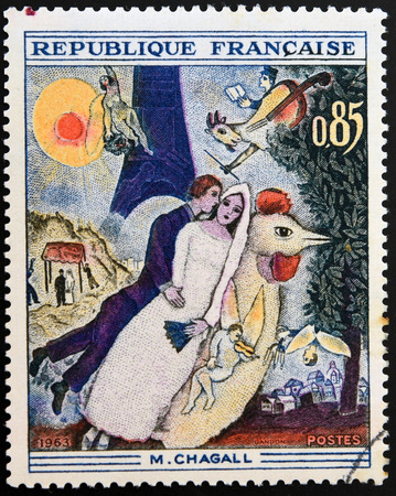 chagall: FRANCE - CIRCA 1963: A stamp printed in France shows engraving after painting Married couple at the Eiffel Tower by Marc Chagall, circa 1963 Editorial