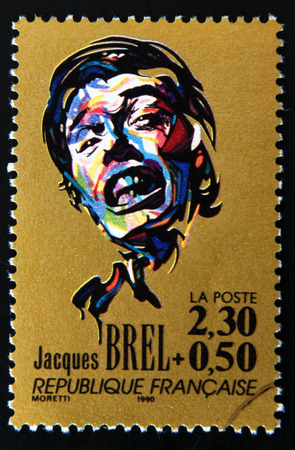 jacques: FRANCE - CIRCA 1990: A stamp printed in France shows portrait of Jacques Brel, circa 1990.