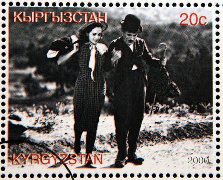 chaplin: KYRGYZSTAN - CIRCA 2000: A stamp printed in Kyrgyzstan shows Paulette Goddard and Charles Chaplin in the movie Modern Times, circa 2000