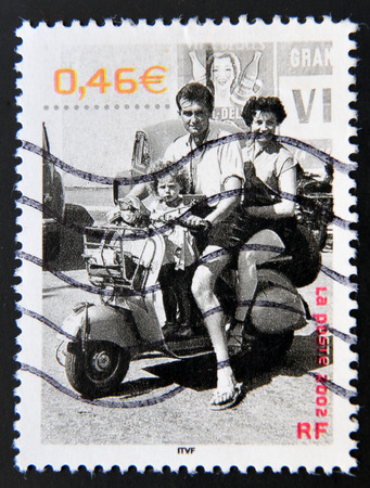 FRANCE - CIRCA 2002: A stamp printed in France shows a family in a beautiful summer, Saint-Brevin-les-Pins (Loire Atlantique), 1.955, circa 2002 Editorial