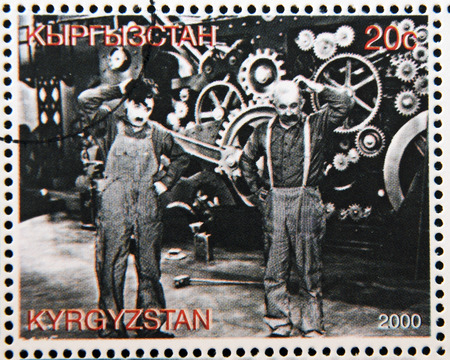 KYRGYZSTAN - CIRCA 2000: A stamp printed in Kyrgyzstan shows scene from the movie Modern Times by Charles Chaplin, circa 2000 新聞圖片