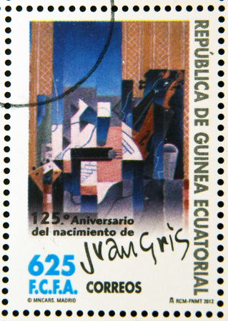 EQUATORIAL GUINEA - CIRCA 2012: A stamp printed in Guinea dedicated to 125th anniversary of the birth of Juan Gris, shows violin and guitar, circa 2012