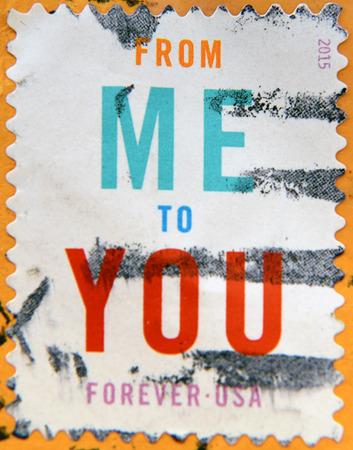 mail me: UNITED STATES OF AMERICA - CIRCA 2015: A stamp printed in USA shows the phrase From Me To You, circa 2015