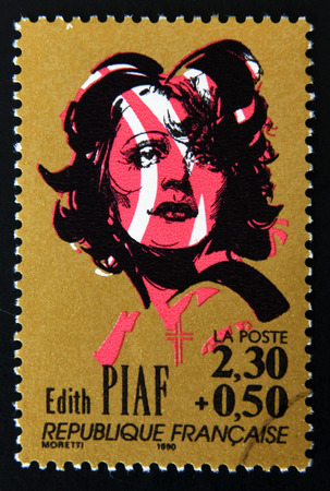 edith: FRANCE - CIRCA 1990: A stamp printed in France shows portrait of Edith Piaf, circa 1990. Editorial