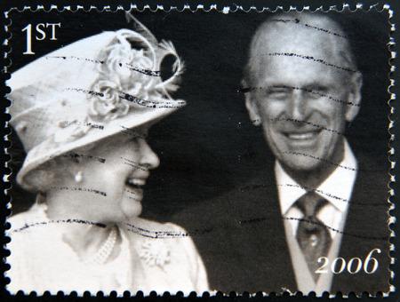 queen elizabeth ii: UNITED KINGDOM - CIRCA 2006: Stamp printed in UK shows Queen Elizabeth II and the Duke of Edinburgh Prince Philip leave St Pauls Cathedral, the Diamond Wedding Anniversary, circa 2006
