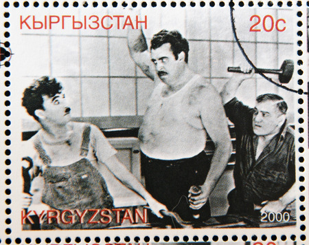 chaplin: KYRGYZSTAN - CIRCA 2000: A stamp printed in Kyrgyzstan shows scene from the movie Modern Times by Charles Chaplin, circa 2000 Editorial