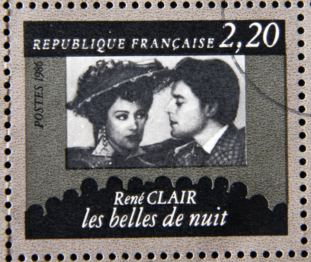 clair: FRANCE - CIRCA 1986: stamp dedicated to centenary of the French cinema shows Rene Clair Beautiful Night, circa 1986