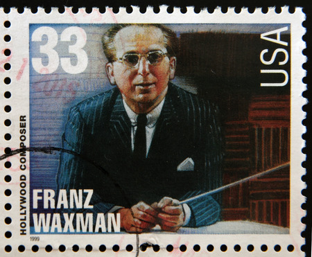 UNITED STATES OF AMERICA - CIRCA 1999: A stamp printed in USA dedicated to Hollywood composer, shows Franz Waxman, circa 1999 Editorial