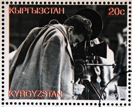KYRGYZSTAN - CIRCA 2000: A stamp printed in Kyrgyzstan shows Charles Chaplin directing a film, circa 2000