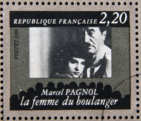 philatelist: FRANCE - CIRCA 1986: stamp dedicated to centenary of the French cinema shows Marcel Pagnol The Bakers Wife, circa 1986