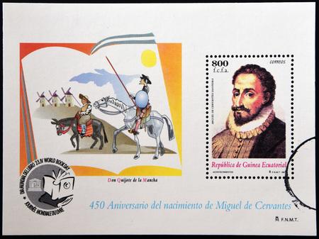 playwright: EQUATORIAL GUINEA - CIRCA 1997: A stamp printed in Guinea shows portrait of Miguel de Cervantes Saavedra (1547-1616), Spanish writer, and Don Quixote, circa 1997
