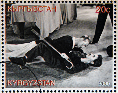 chaplin: KYRGYZSTAN - CIRCA 2000: A stamp printed in Kyrgyzstan shows scene from a movie of Charles Chaplin fighting a mannequin, circa 2000 Editorial