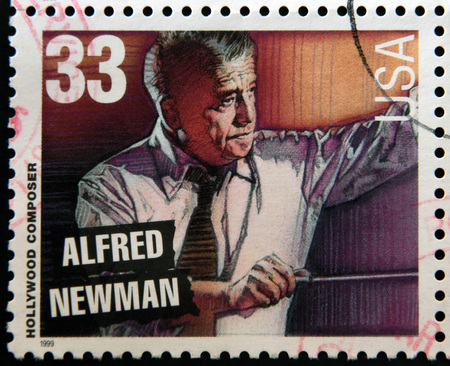 composer: UNITED STATES OF AMERICA - CIRCA 1999: A stamp printed in USA dedicated to Hollywood composer, shows Alfred Newman, circa 1999