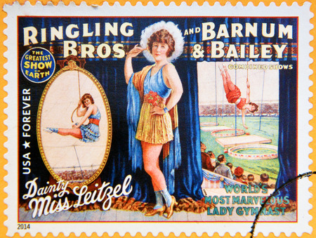 dainty: UNITED STATES OF AMERICA - CIRCA 2014: A stamp printed in USA shows Dainty Miss Leitzel; worls most marvelous lady gymnast; circus vintage posters; Ringling Bros, Barnum & Bailey, circa 2014