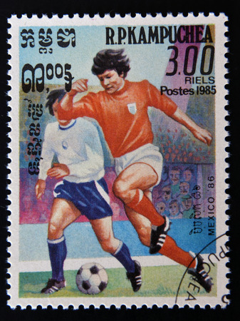kampuchea: KAMPUCHEA - CIRCA 1985: A  stamp printed in Cambodia dedicated to Mexico World Cup in 1986, shows an image of football players, circa 1985