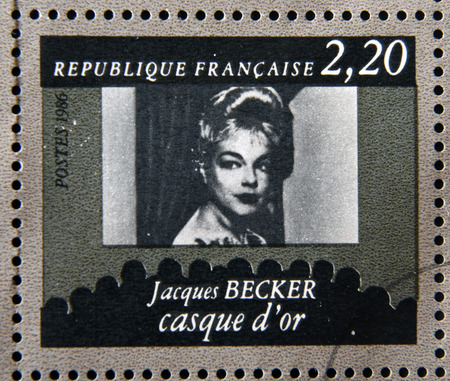 casque: FRANCE - CIRCA 1986: stamp dedicated to centenary of the French cinema shows Jacques Becker Casque dOr, circa 1986