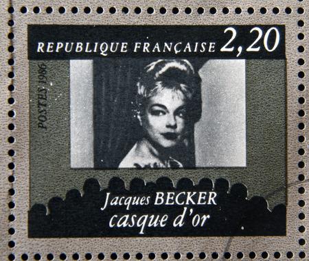 jacques: FRANCE - CIRCA 1986: stamp dedicated to centenary of the French cinema shows Jacques Becker Casque dOr, circa 1986