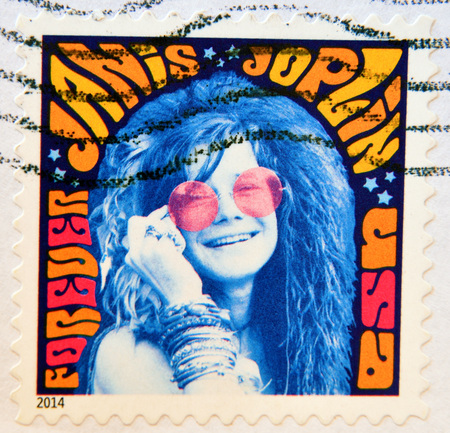 woodstock: UNITED STATES OF AMERICA - CIRCA 2014: A stamp printed in USA shows music icon Janis Joplin; psychedelic soul; singer; Woodstock festival; Rock & Roll hall of fame, circa 2014 Editorial