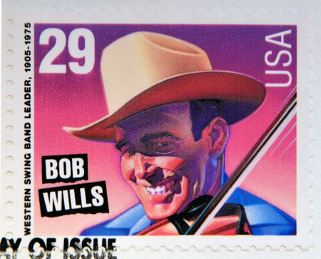 western usa: UNITED STATES OF AMERICA - CIRCA 1993: A stamp printed in USA shows Bob Wills (Western swing band leader), circa 1993.