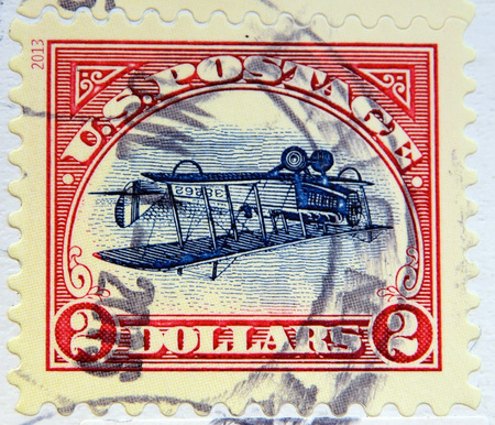 curtis: UNITED STATES OF AMERICA - CIRCA 2013: A stamp printed in USA shows Inverted Curtis Jenny Biplane, circa 2013 Editorial
