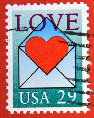 philatelist: UNITED STATES OF AMERICA - CIRCA 1991: A stamp printed in USA shows red heart in love letter, circa 1991
