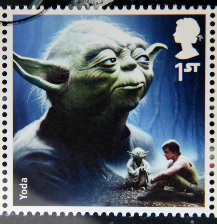 philately: UNITED KINGDOM - CIRCA 2015: a stamp printed in Great Britain commemorative of Star Wars movie, shows Yoda, circa 2015.
