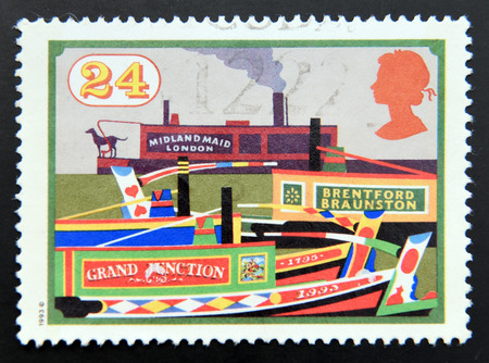 inland waterways: UNITED KINGDOM - CIRCA 1993: A stamp printed in Great Britain dedicated to Inland Waterways, shows Midland Maid and other Narrow Boats, Grand Junction Canal, circa 1993