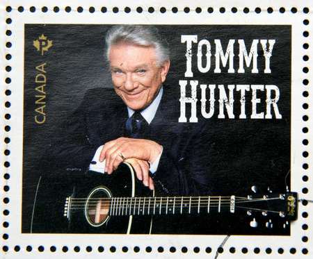 philatelist: CANADA - CIRCA 2014: Stamp printed in Canada dedicated to canadian country artist, shows Tommy Hunter, circa 2014