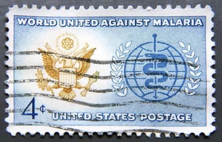 eradication: UNITED STATES OF AMERICA - CIRCA 1962: A stamp printed in USA shows Great Seal of U.S. and World Health Organization (WHO) Symbol, Malaria Eradication Issue, circa 1962