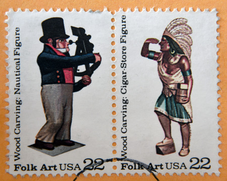 indian postal stamp: UNITED STATES OF AMERICA - CIRCA 1986: Stamps printed in USA, shows Wood carved: Nautical Figure and Cigar Store Figure, circa 1986