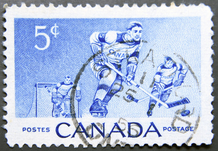 canada stamp: CANADA - CIRCA 1956: A stamp printed in Canada shows ice hockey, circa 1956
