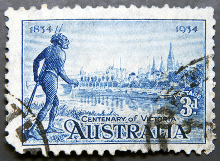 AUSTRALIA - CIRCA 1934: Stamp printed in Australia shows the Yarra Yarra Tribesman, Yarra River and View of Melbourne, Centenary of Victoria, circa 1934