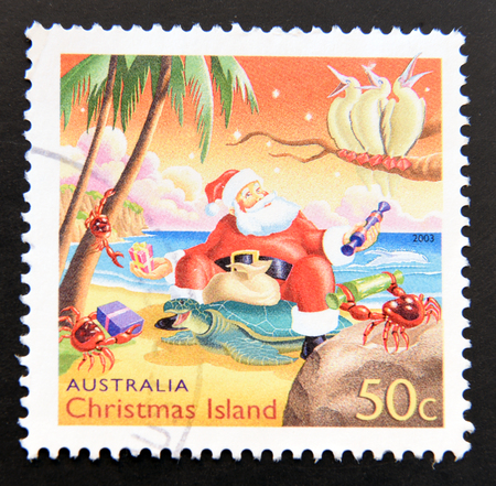 postage stamp: AUSTRALIA - CIRCA 2009: A stamp printed in Australia dedicated to christmas in Australia, shows Santa Claus at the beach, circa 2009 Stock Photo