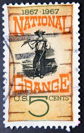 poststempel: UNITED STATES OF AMERICA - CIRCA 1967: Ein Stempel zeigt Grange Plakat 1870 Centenary die Gründung des Nationalen Grange, amerikanischen Bauern Organisation
