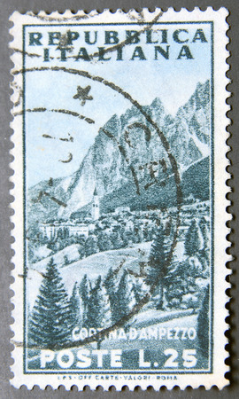commemorate: ITALY - CIRCA 1953: a postage stamp of Italy shows View of Mountain, Cortina dAmpezzo