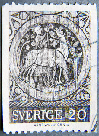 tending: SWEDEN - CIRCA 1970: A postage stamp of Sweden shows St. Stephen as a boy tending horses, medallion from Dadesio Church