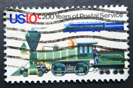 united states postal service: UNITED STATES OF AMERICA - CIRCA 1992: A stamp shows steam locomotive, 200 Years of Postal Service