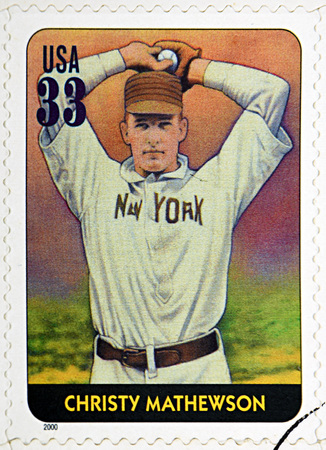 outfield: GRANADA, SPAIN - DECEMBER 1, 2015: A stamp printed in USA dedicated to Legends of Baseball shows Christy Mathewson, 2000