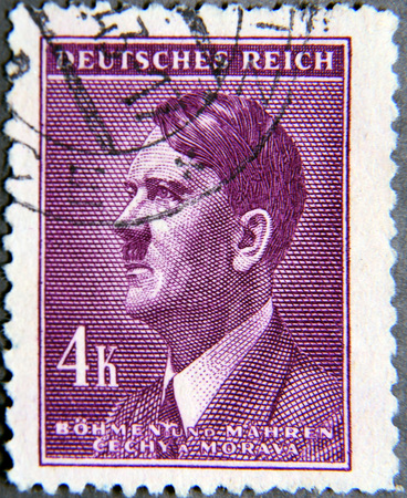 hitler: GRANADA, SPAIN - NOVEMBER 15, 2015:   stamp printed in the Protectorate Czech and Morava shows portrait of Adolf Hitler, circa 1942 Editorial
