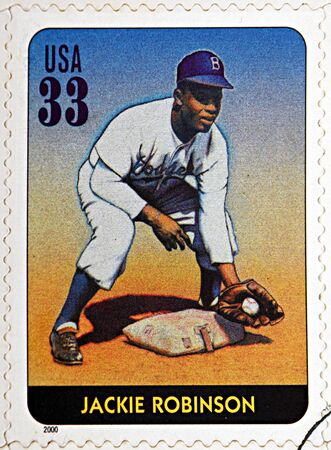pitcher: GRANADA, SPAIN - DECEMBER 1, 2015: A stamp printed in USA dedicated to Legends of Baseball shows Jackie Robinson, 2000