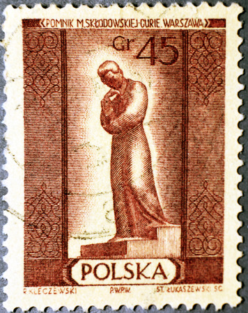 discoverer: GRANADA, ESPA�A - 15 de noviembre, 2015: sello impreso en Polska muestra Marie Sklodowska Curie 1867-1934 estatua de Varsovia; descubridor del radio y el polonio, alrededor de 1960