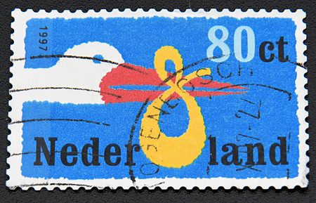 birth announcement: GRANADA, SPAIN - NOVEMBER 30, 2015:   Stamp printed in Netherlands dedicated to Birth Announcement shows the stork bears the baby, 1997.
