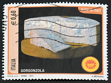 veining: GRANADA, SPAIN - NOVEMBER 30, 2015:  a stamp printed in Italy shows gorgonzola cheese , 2011