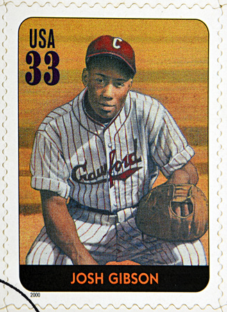 gibson: GRANADA, SPAIN - DECEMBER 1, 2015: A stamp printed in USA dedicated to Legends of Baseball shows Josh Gibson, 2000