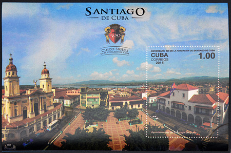 GRANADA, SPAIN - DECEMBER 1, 2015: A stamp printed in Cuba dedicated to the 500th anniversary of the foundation of Santiago, shows the City Hall Santiago de Cuba, 2015