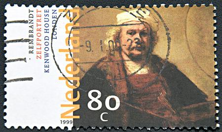 rembrandt: GRANADA, SPAIN - NOVEMBER 30, 2015:   A stamp printed in Netherlands shows Self-portrait  by Rembrandt, 1999