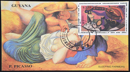 picasso: GRANADA, SPAIN - DECEMBER 1, 2015: Stamp printed in Guyana shows still life with guitar and sleeping farmers by Picasso, 1990