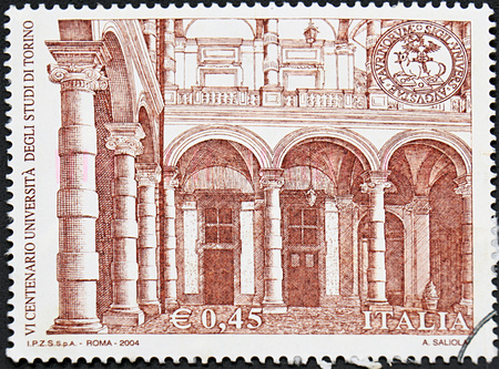 university of granada: GRANADA, SPAIN - NOVIEMBRE 30, 2015: A stamp printed in Italy shows University of Turin, 600th Anniv., 2004 Editorial